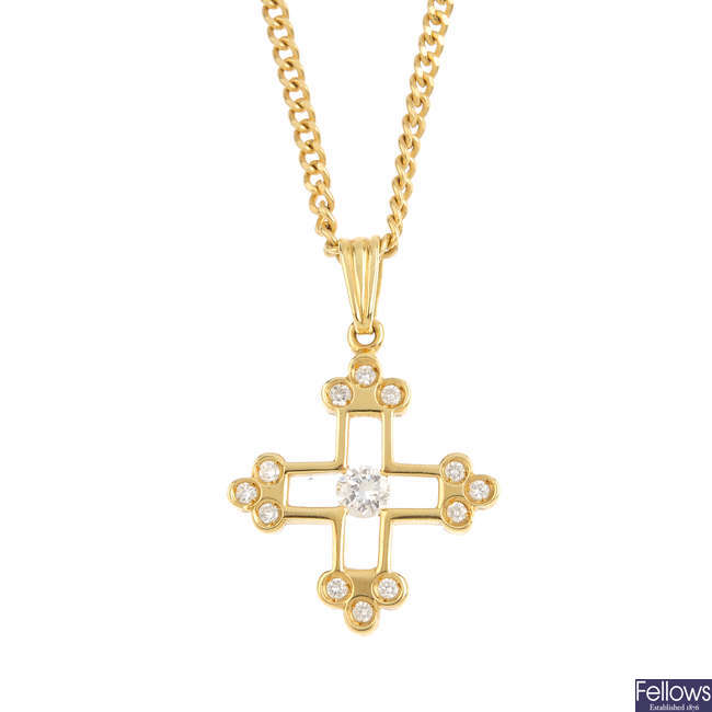 An 18ct gold diamond cross pendant, with chain.