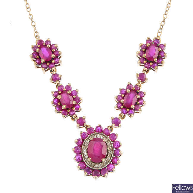 A silver glass-filled ruby and gem-set necklace.