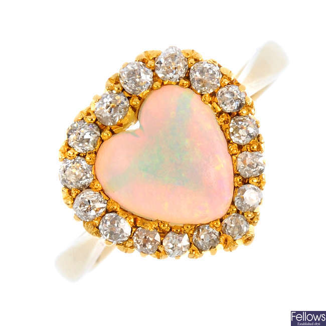 An early 20th century gold, opal and diamond cluster ring.