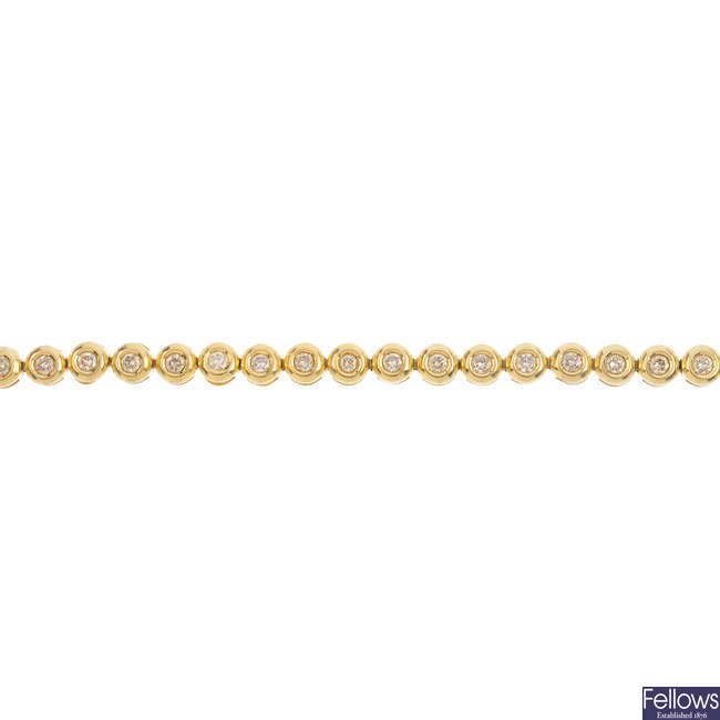 An 18ct gold diamond bracelet.