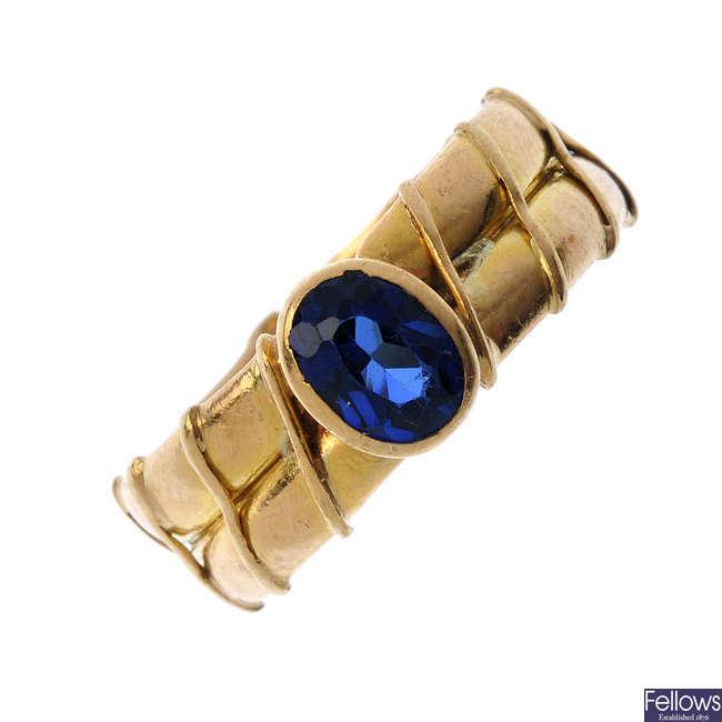 A sapphire single-stone ring.