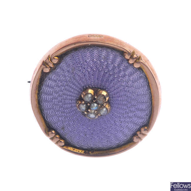 An early 20th century 9ct gold split pearl and enamel brooch.