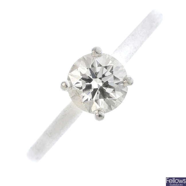 DE BEERS - a platinum diamond single-stone ring.