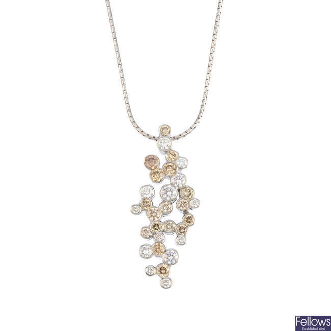 An 18ct gold diamond pendant, on chain.