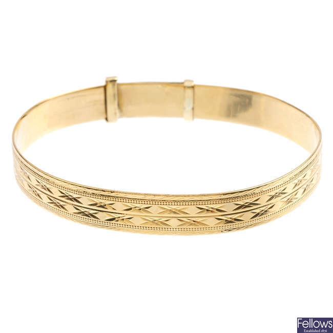 A 9ct gold bangle.