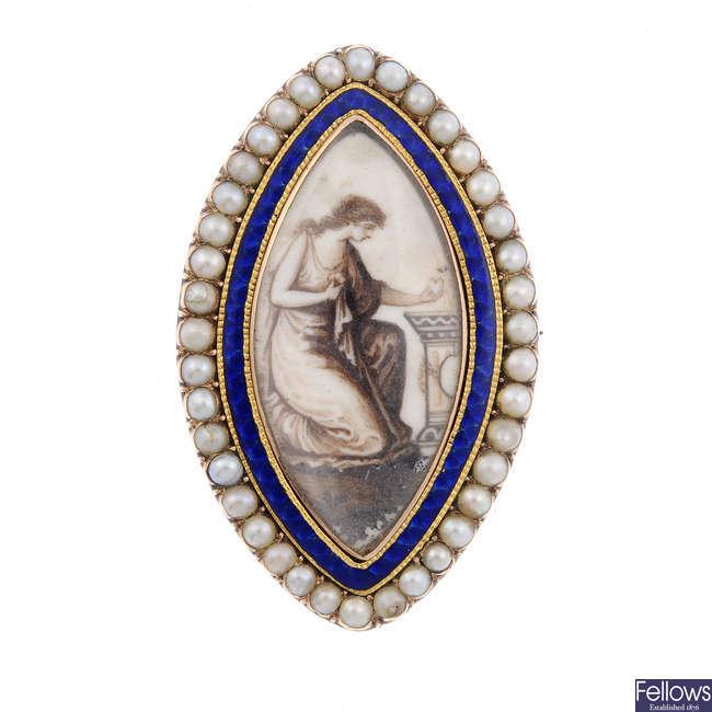 A late Georgian split pearl and enamel mourning brooch.