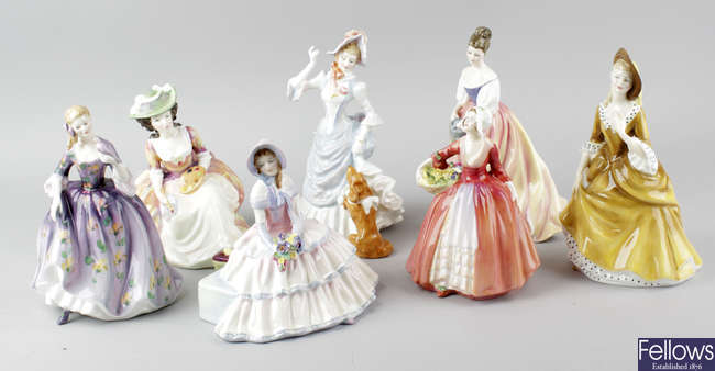 A group of seven Royal Doulton figurines.