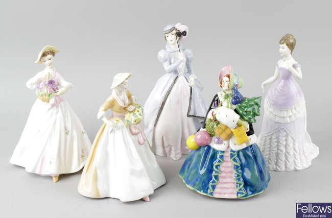 A group of five Royal Doulton figurines.