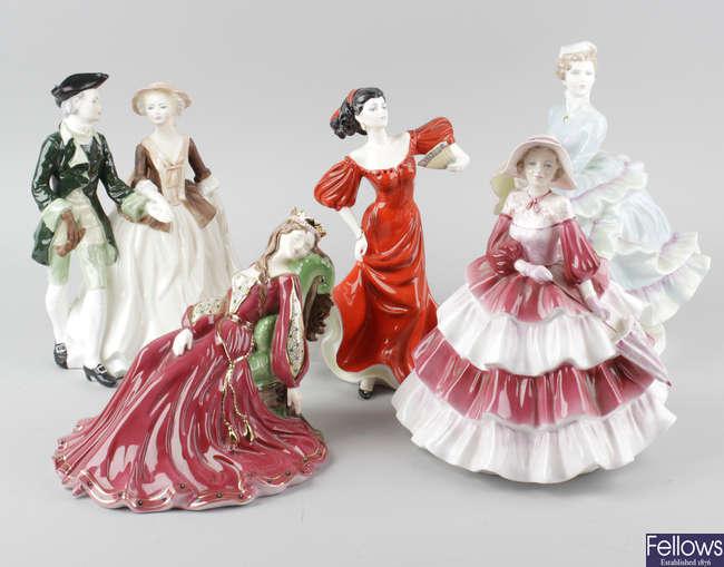 A group of thirteen assorted Coalport figurines.