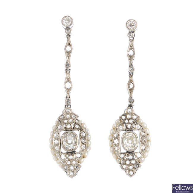 A pair of seed pearl and diamond earrings.