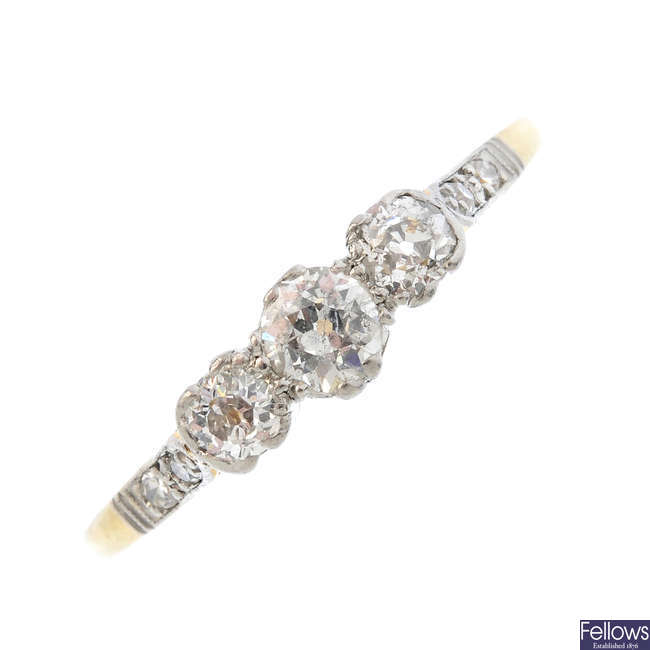 An mid 20th century 18ct gold and platinum diamond three-stone ring.