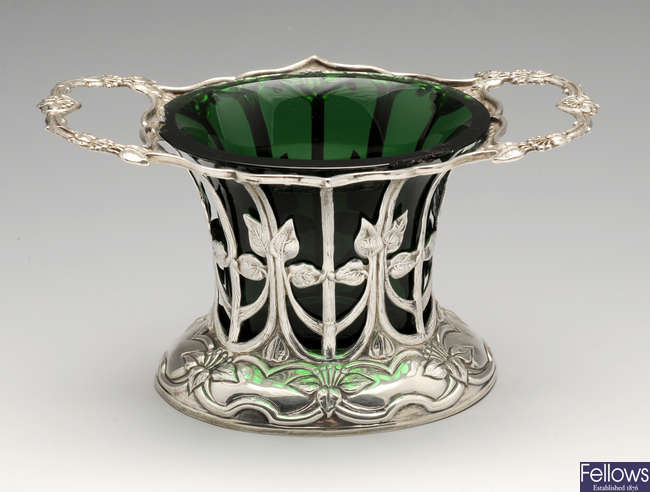 An Art Nouveau small pierced silver dish with liner.