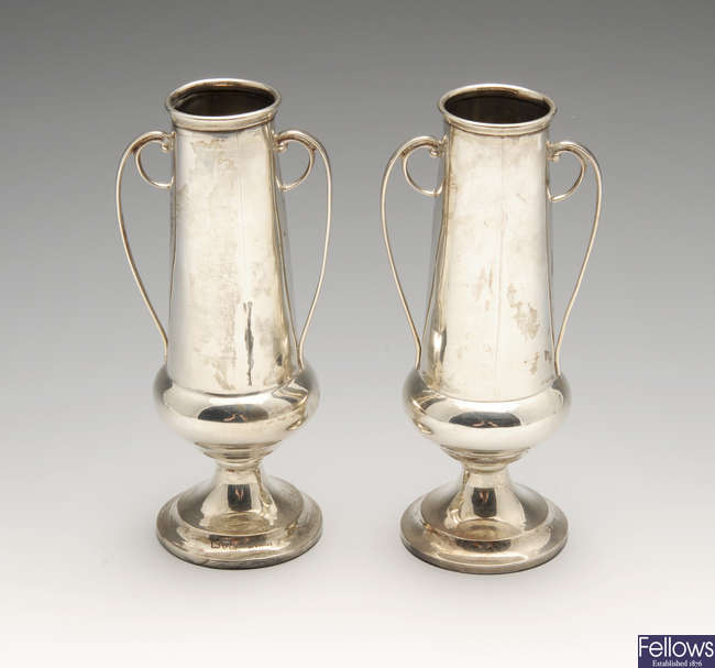 A pair of small Edwardian silver twin-handled vases with filled bases.