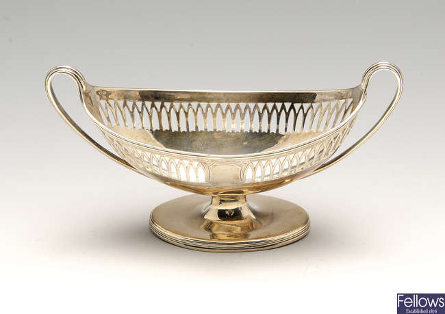 A George III silver pedestal salt, a 1920's cream jug & pierced basket with liner. (3).