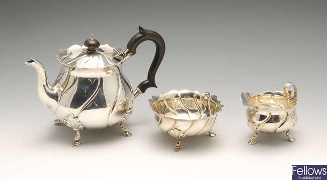 A late Victorian silver three piece bachelor tea service.