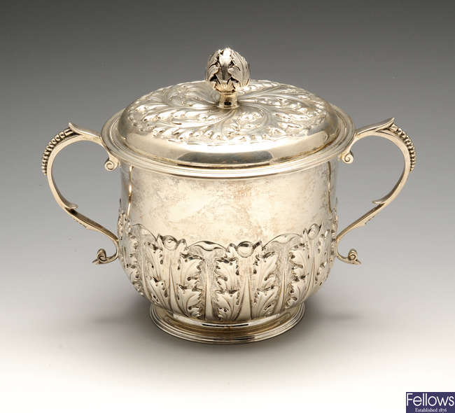 An early 20th century silver twin-handled cup & cover.