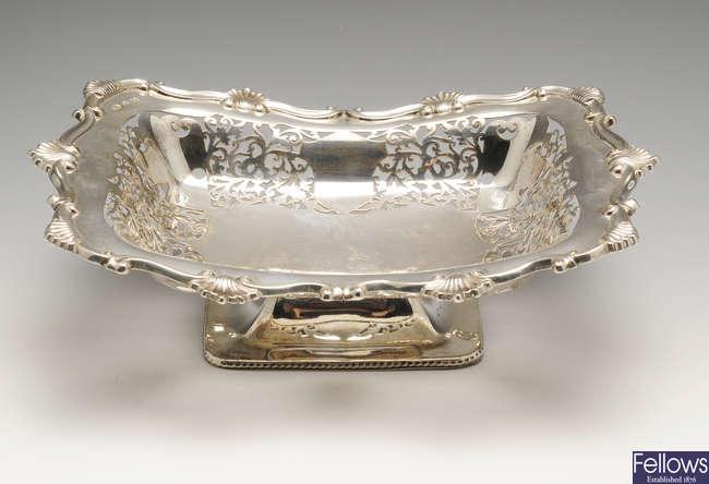 An Edwardian silver pierced dish on footed base.