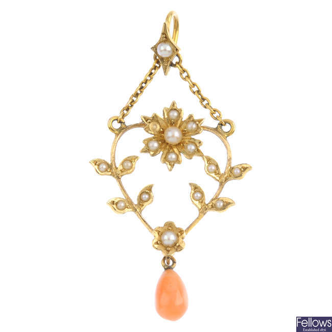 An early 20th century gold coral and pearl pendant.