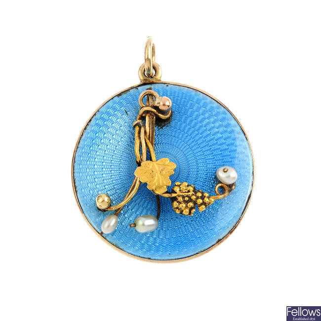 An early 20th century seed pearl and enamel locket.