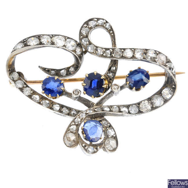 An Art Nouveau silver and gold, sapphire and diamond brooch.