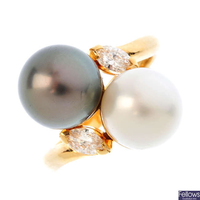 A cultured pearl and diamond crossover ring.