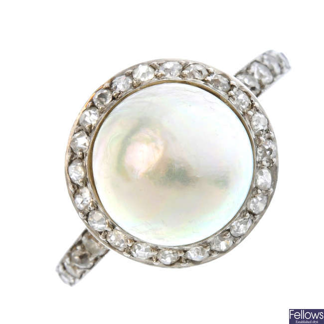 An early 20th century platinum, pearl and diamond ring.