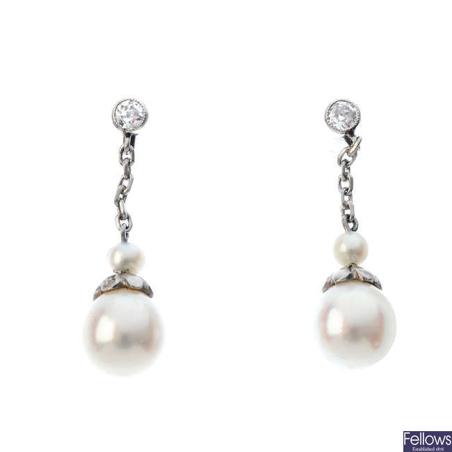 A pair of cultured pearl and diamond earrings.