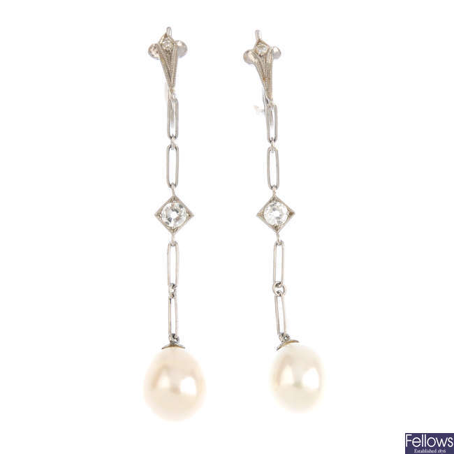 A pair of early 20th century pearl and diamond earrings.