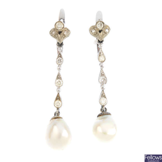 A pair of mid 20th century pearl and diamond earrings.