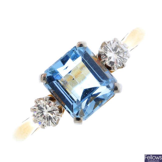 An aquamarine and diamond three-stone ring.