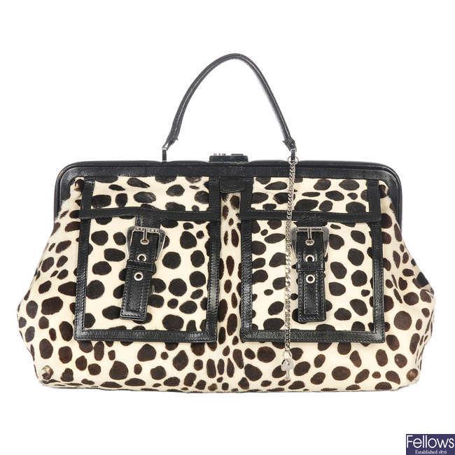 CÉLINE - a Dalmatian print pony hair handbag.