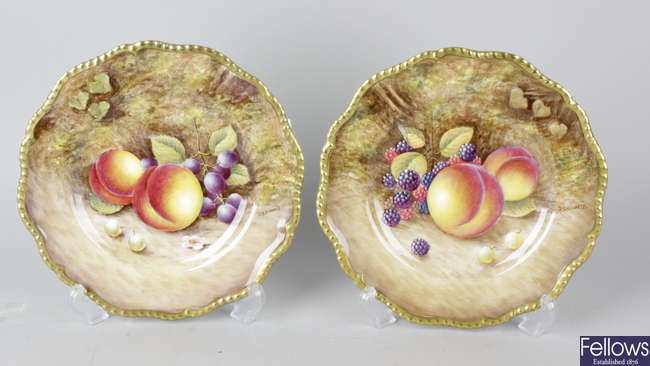 A pair of Royal Worcester porcelain fruit-painted plates
