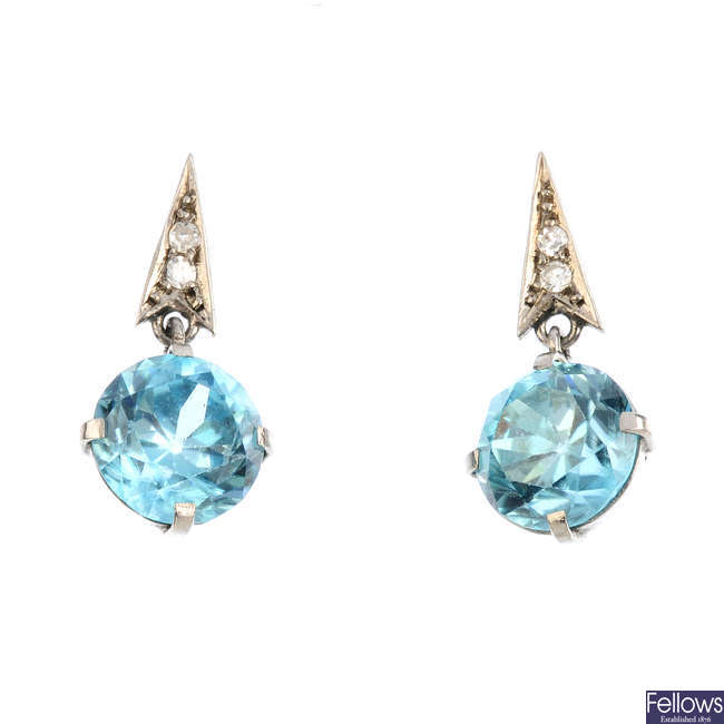 A pair of blue zircon and diamond earrings.