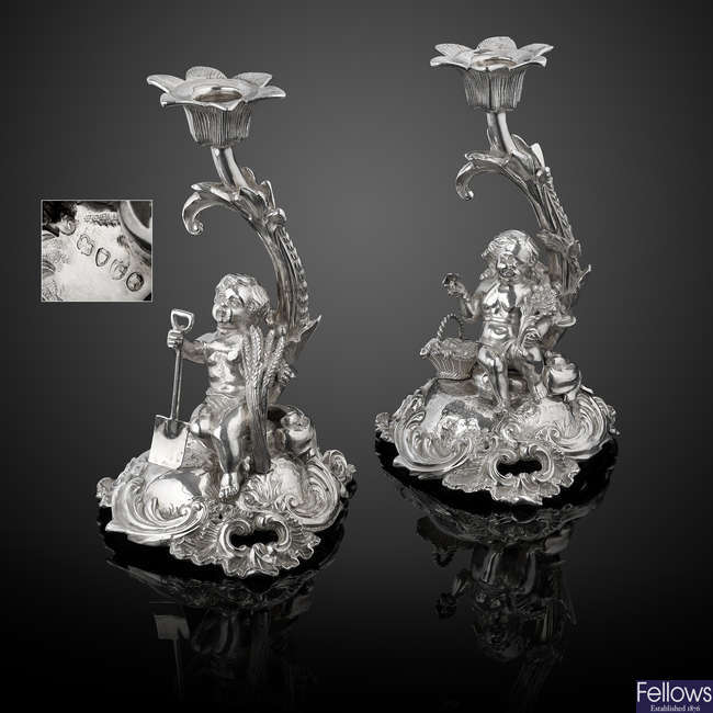 A pair of Victorian silver figural candlesticks in Rococo style.
