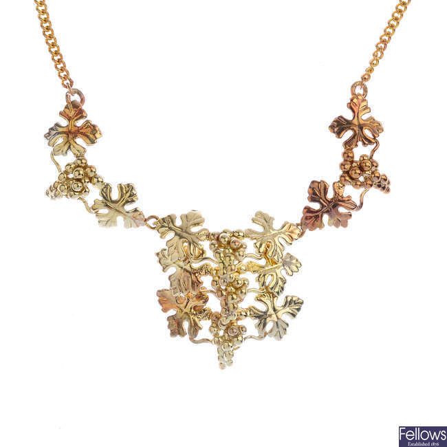 A 9ct gold grape and vine necklace.