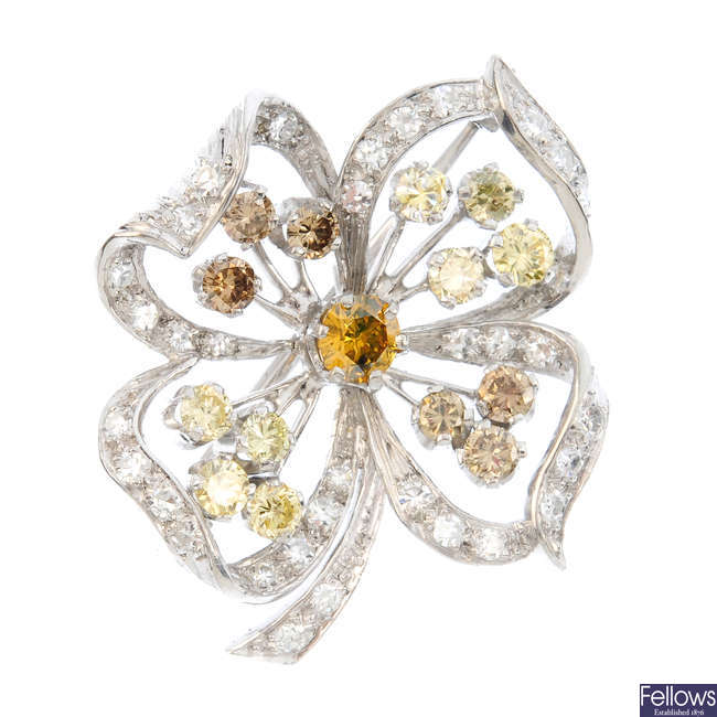 A diamond and 'coloured' diamond brooch.