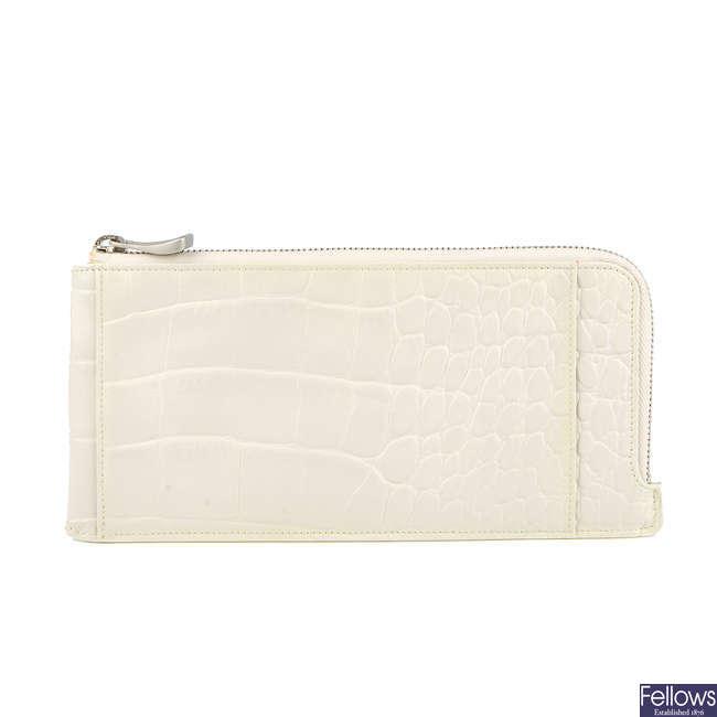 ALEXANDER MCQUEEN for Samsonite - an ivory travel wallet.