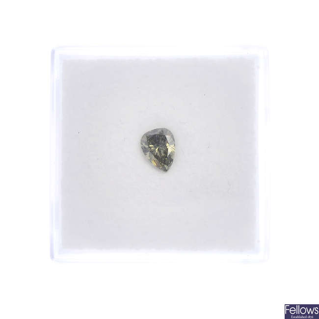 A loose natural fancy diamond.