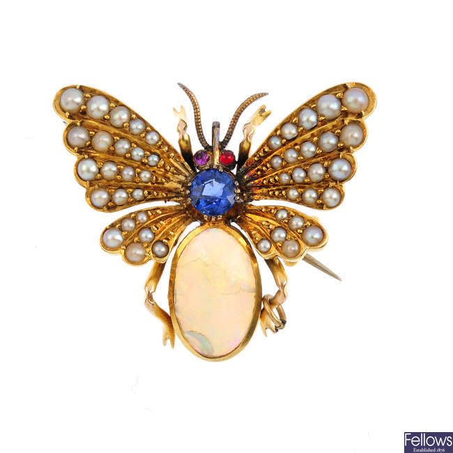 A late Victorian gold, sapphire, split pearl and opal butterfly brooch.