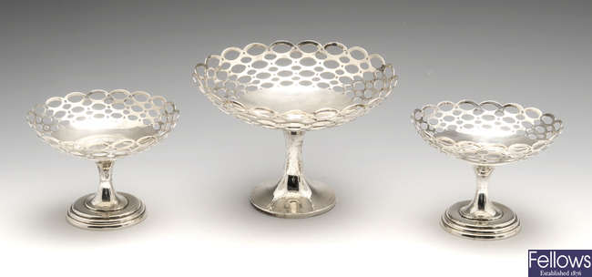 An early 20th century matched garniture of three silver pedestal dishes.
