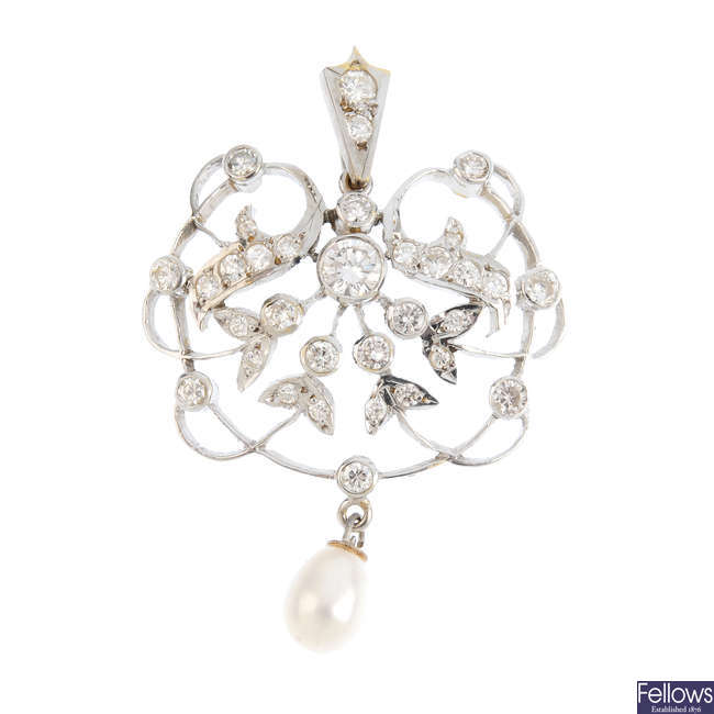 A diamond and cultured pearl pendant.