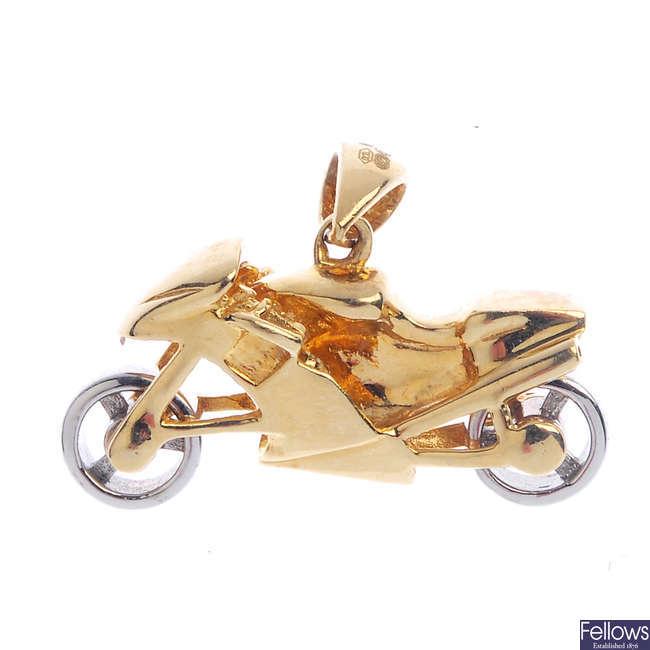 A 9ct gold motorbike pendant.