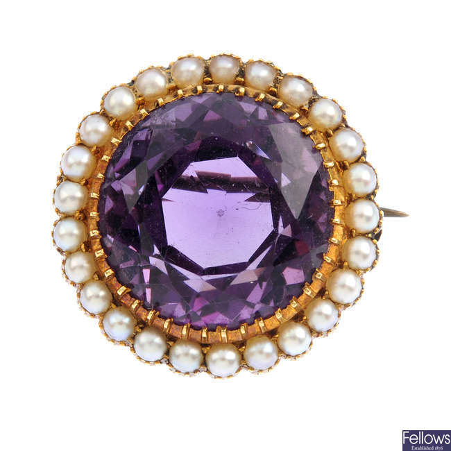 An amethyst and split pearl brooch.