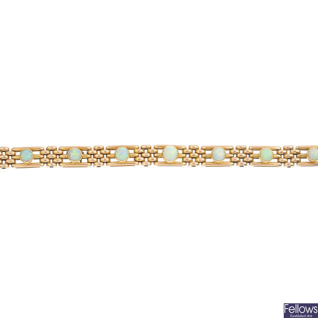 An early 20th century 15ct gold opal gate bracelet.