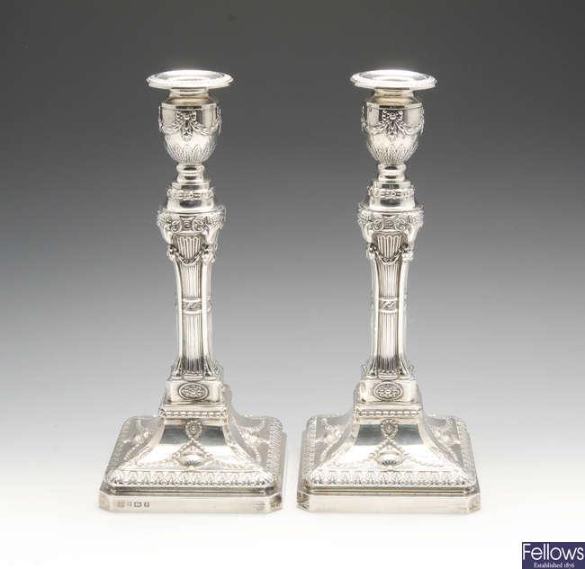 A pair of modern silver candlesticks.