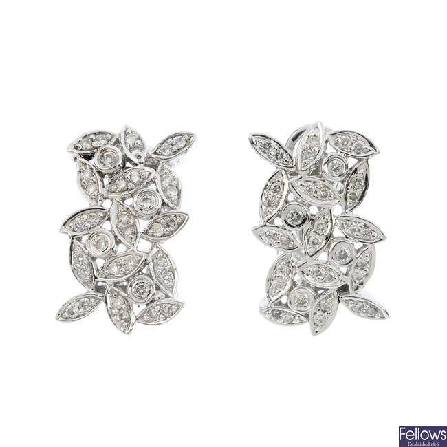 A pair of diamond earrings.