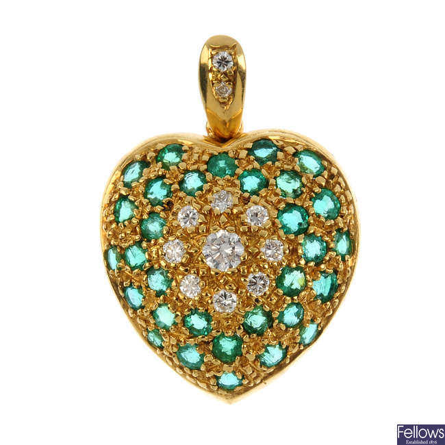 An 18ct gold emerald and diamond heart pendant.