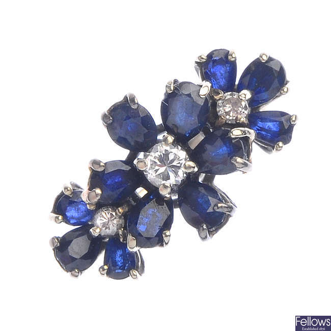 A diamond and sapphire floral dress ring.