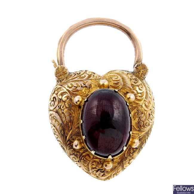 A late Victorian garnet cabochon, memorial heart padlock clasp.