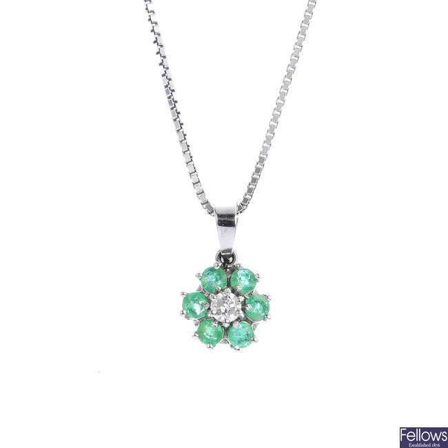 An emerald and diamond pendant, with 18ct gold chain.